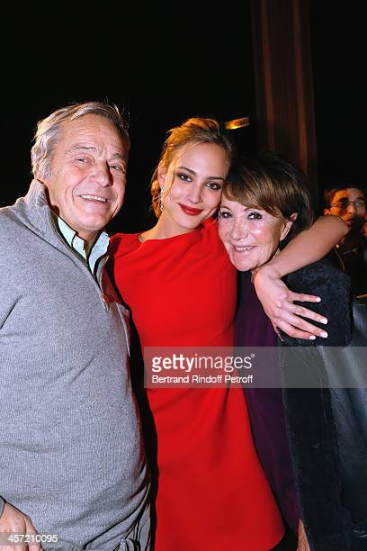 Actress Nora Arnezeder standing between Yaguel Didier and her husband Partrick de Bourgues the 'Angelique' Paris movie premiere after screening at...