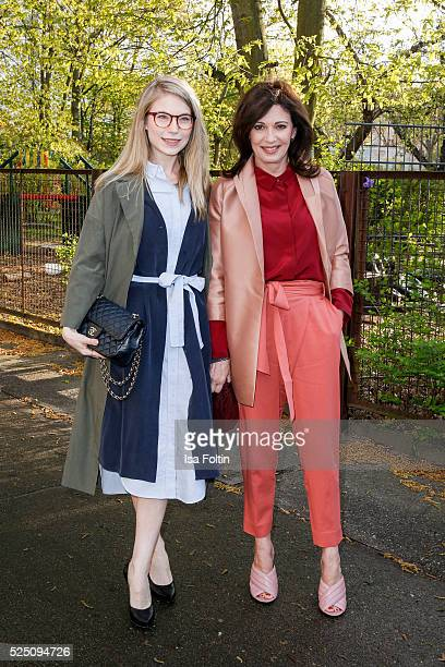 Actress Nora von Waldstaetten wearing a dress of COS and actress iris Berben wearing a dress of COS attend the presentation of a joint project by COS...