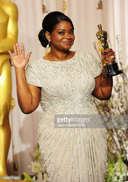 Actress Octavia Spencer, winner of the Best Supporting Actress Award for 'The Help,' poses in the press room at the 84th Annual Academy Awards held...