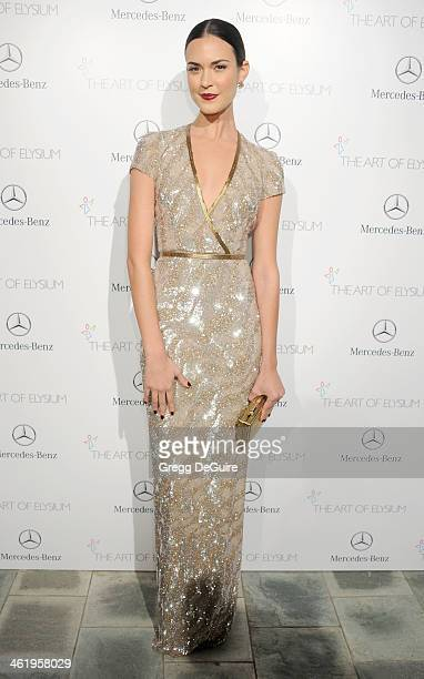 Actress Odette Yustman arrives at The Art of Elysium's 7th Annual HEAVEN Gala at the Guerin Pavilion at the Skirball Cultural Center on January 11...