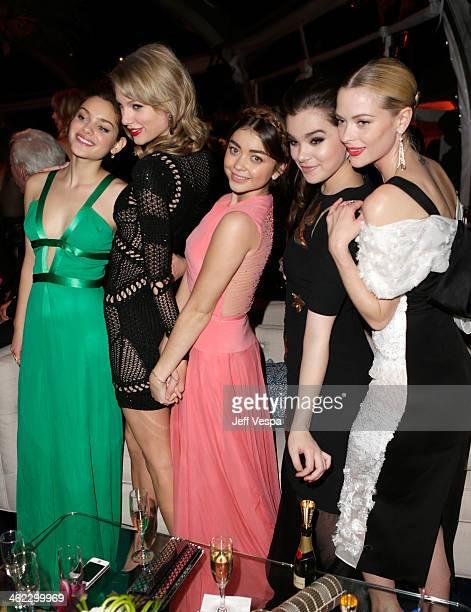 Actress Odeya Rush musician Taylor Swift actresses Sarah Hyland Hailee Steinfeld and Jaime King attend The Weinstein Company Netflix's 2014 Golden...