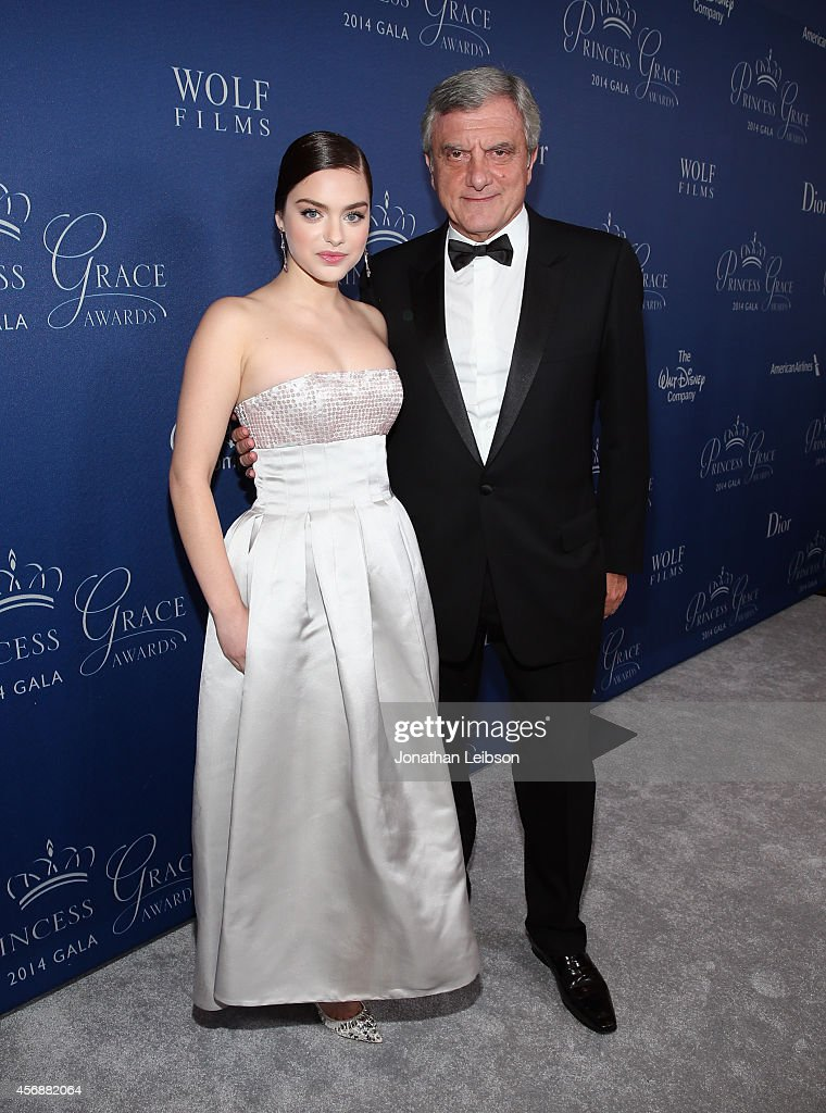 Actress Odeya Rush, wearing Dior, and Princess Grace Awards Gala Co-Chair and President/CEO of Christian Dior Couture Sidney Toledano (R) attend 2014 Princess Grace Awards Gala at Regent Beverly Wilshire Hotel on October 8, 2014 in Beverly Hills, California.