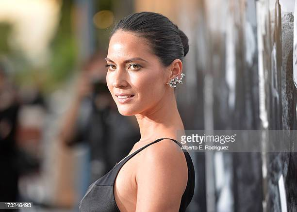 Actress Oivia Munn arrives for the premiere of HBO's The Newsroom Season 2 at Paramount Theater on the Paramount Studios lot on July 10 2013 in...