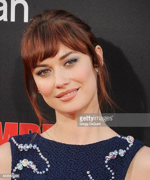 Actress Olga Kurylenko arrives at the Los Angeles premiere of 'The November Man' at TCL Chinese Theatre on August 13 2014 in Hollywood California