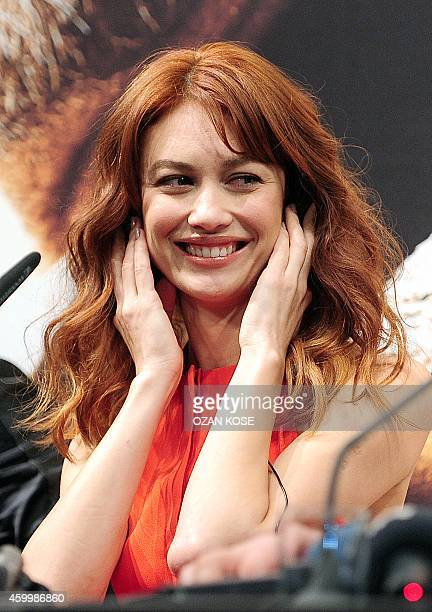 Actress Olga Kurylenko gestures during a press conference at Turkish the premiere of 'The Water Diviner' on December 5 2014 in Istanbul 'The Water...