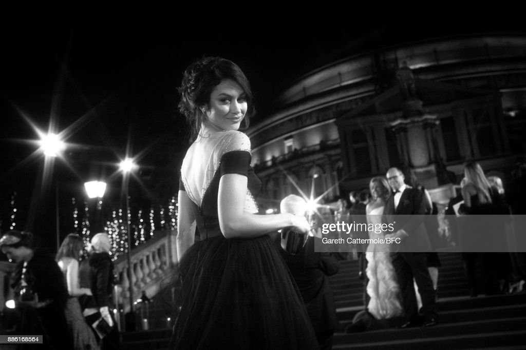 Actress Olga Kurylenko walks the red carpet during The Fashion Awards 2017 in partnership with Swarovski at Royal Albert Hall on December 4, 2017 in London, England.