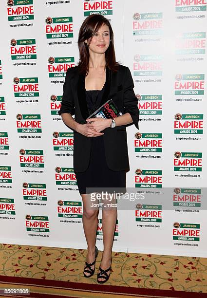 Actress Olga Kurylenko with the Best Thriller award for Quantum of Solace during the Jameson Empire Awards at the Grosvenor House Hotel on March 29...