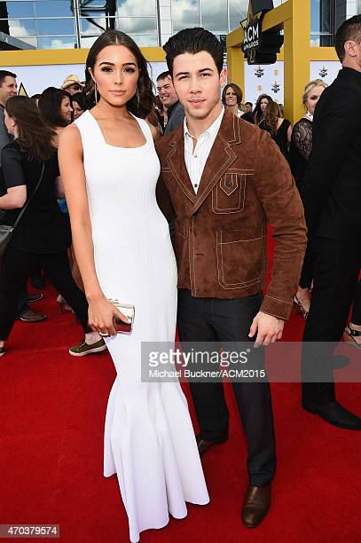 Actress Olivia Culpo and singersongwriter Nick Jonas attend the 50th Academy of Country Music Awards at ATT Stadium on April 19 2015 in Arlington...