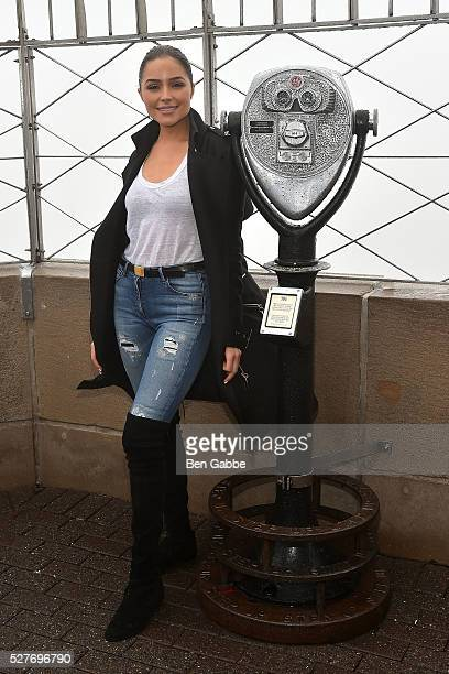 Actress Olivia Culpo visits The Empire State Building in Honor of Project Sunshine on May 03 2016 in New York New York