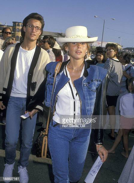 Actress Olivia d'Abo and date attend a Performance of Cirque du Solei on March 27, 1988 at Santa Monica Pier in Santa Monica, California.