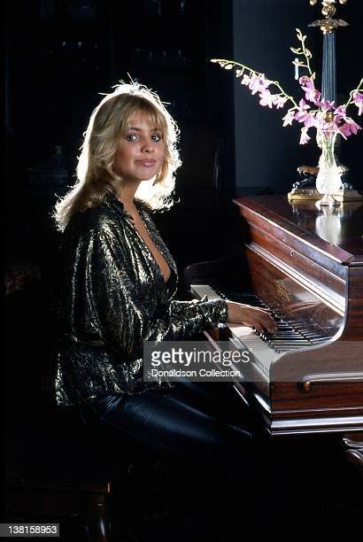 Actress Olivia d'Abo plays piano in a portrait session in 1984 in Los Angeles, California.