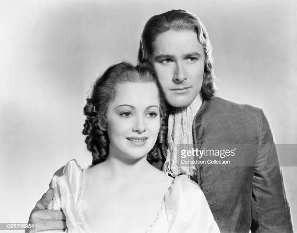 Actress Olivia de Havilland and Errol Flynn in a scene from the movie Captain Blood