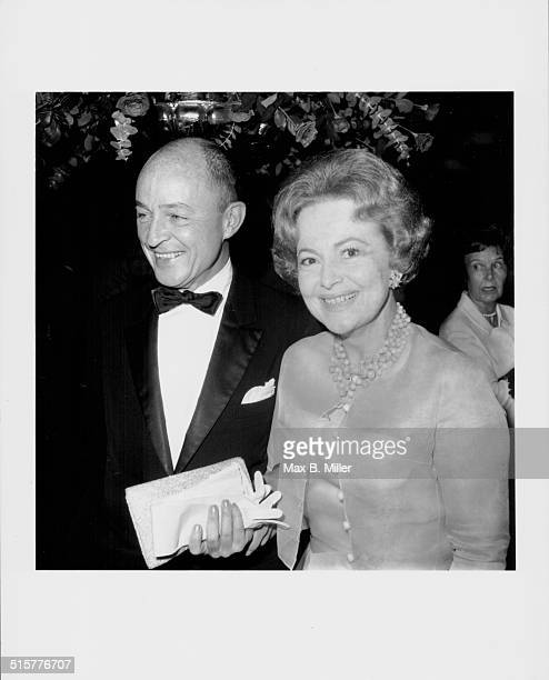 Actress Olivia de Havilland and guest attending the Italian Ball October 1966