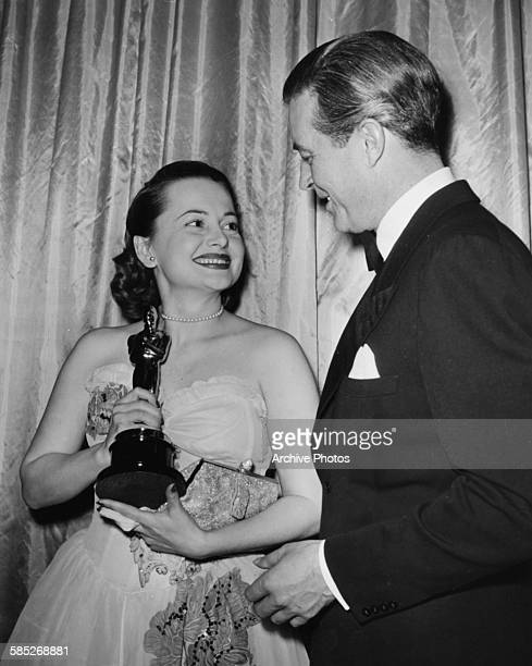 Actress Olivia de Havilland holding her Best Actress Oscar for the film 'To Each His Own', with presenter Ray Milland, at the 19th Academy Awards,...