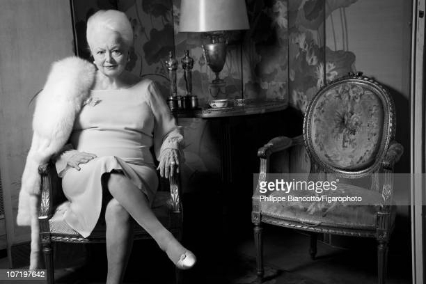 Actress Olivia de Havilland poses at home with her Oscars for Madame Figaro on October 14 2010 Published image Figaro ID 098972006 Fur by Yves...