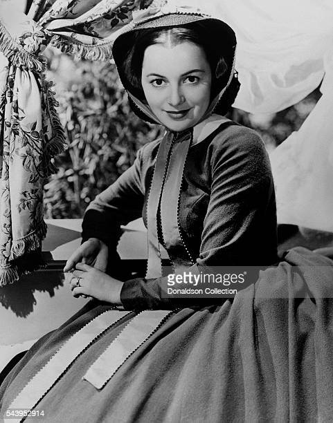 Actress Olivia de Havilland poses for a publicity Still for the Selznick/MGM film Gone With the Wind in 1939 in Los Angeles California