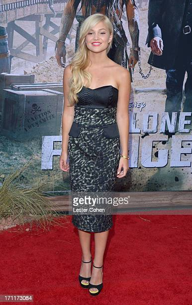 Actress Olivia Holt arrives at Disney's The Lone Ranger World Premiere at Disney's California Adventure on June 22 2013 in Anaheim California