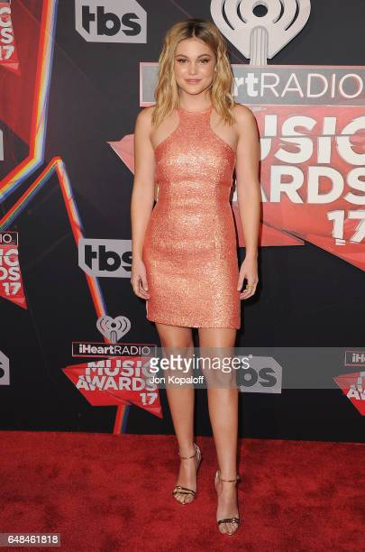Actress Olivia Holt arrives at the 2017 iHeartRadio Music Awards at The Forum on March 5 2017 in Inglewood California