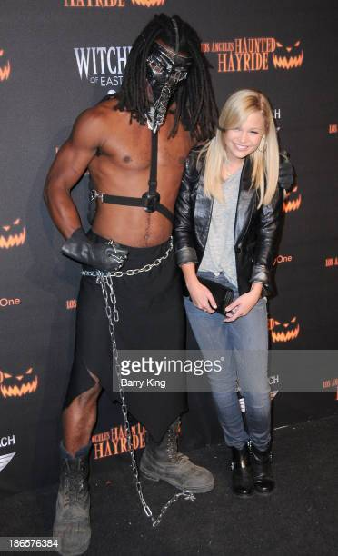 Actress Olivia Holt arrives at the 5th Annual Los Angeles Haunted Hayride opening night on October 10 2013 in Griffith Park in Los Angeles California