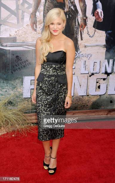 Actress Olivia Holt arrives at The Lone Ranger World Premiere at Disney's California Adventure on June 22 2013 in Anaheim California