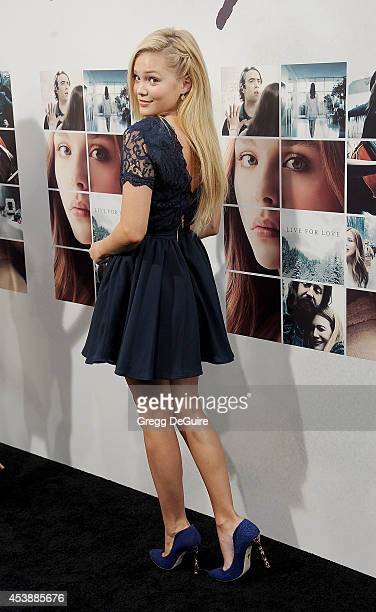 Actress Olivia Holt arrives at the Los Angeles premiere of 'If I Stay' at TCL Chinese Theatre on August 20 2014 in Hollywood California