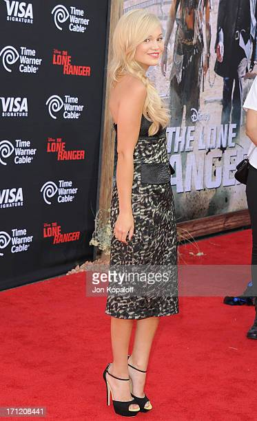 Actress Olivia Holt arrives at the Los Angeles premiere The Lone Ranger at Disney California Adventure Park on June 22 2013 in Anaheim California