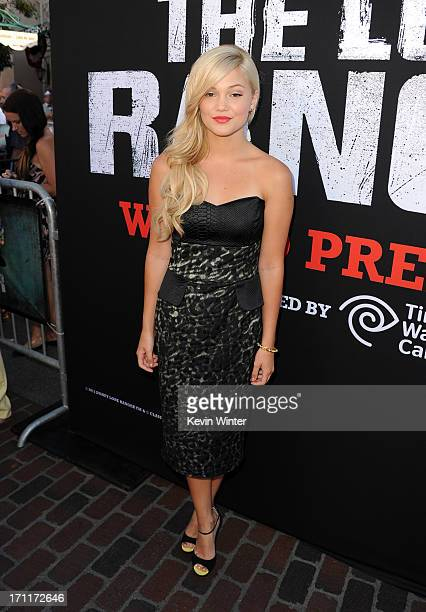 Actress Olivia Holt arrives at the premiere of Walt Disney Pictures' The Lone Ranger at Disney California Adventure Park on June 22 2013 in Anaheim...