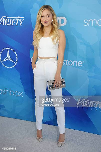 Actress Olivia Holt arrives at the WWD And Variety Inaugural Stylemakers' Event at Smashbox Studios on November 19 2015 in Culver City California