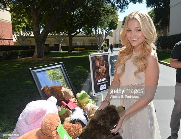 Actress Olivia Holt attends the Disneynature 'Bears' special screening at the Walt Disney Studios Main Theatre on April 5 2014 in Burbank California
