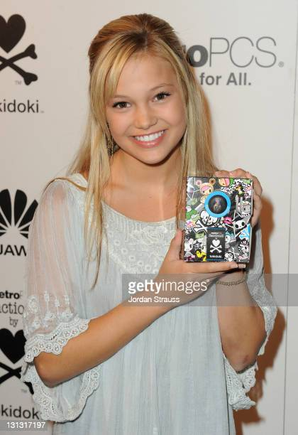 Actress Olivia Holt attends the launch of the MetroPCS Huawei M835 sanctioned by tokidoki at the tokidoki flagship store on November 3 2011 in Los...