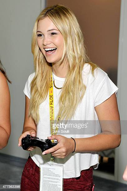 Actress Olivia Holt attends the Nintendo hosts celebrities at 2015 E3 Gaming Convention at Los Angeles Convention Center on June 16 2015 in Los...