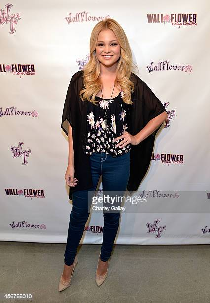 Actress Olivia Holt hosts Wallflower Jeans Fashion Night Out on October 6 2014 in Los Angeles California