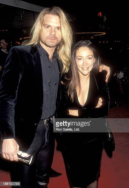 Actress Olivia Hussey and husband David Glen Eisley attend the 'Hamlet' Westwood Premiere on December 18 1990 at Mann Village Theatre in Westwood...