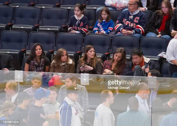 Actress Olivia Munn Alexi Ashe actress Jennifer Carpenter Alexi Ashe and guest attend the Carolina Hurricanes vs the New York Rangers game at Madison...