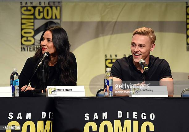 Actress Olivia Munn and actor Ben Hardy from XMen Apocalypse speak onstage at the 20th Century FOX panel during ComicCon International 2015 at the...
