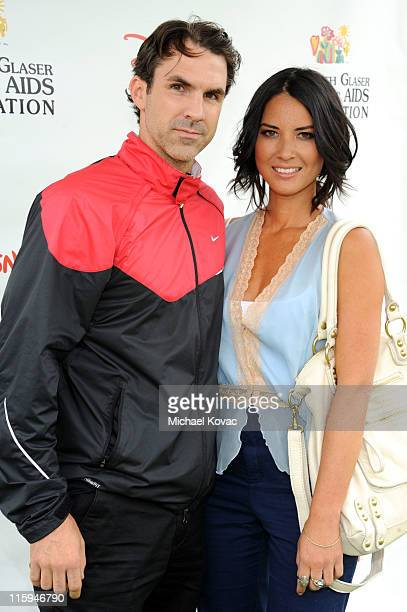 Actress Olivia Munn and actor Paul Schneider arrive at the 22nd Annual Time for Heroes Celebrity Picnic sponsored by Disney to benefit the Elizabeth...