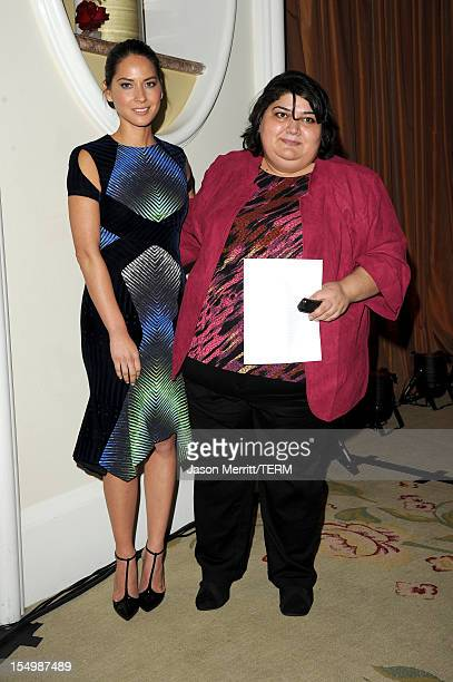 Actress Olivia Munn and Honoree Khadija Ismayilova attend the 2012 Courage in Journalism Awards hosted by the International Women's Media Foundation...