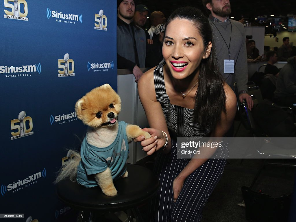 Actress Olivia Munn and Jiffpom visit the SiriusXM set at Super Bowl 50 Radio Row at the Moscone Center on February 5, 2016 in San Francisco, California.