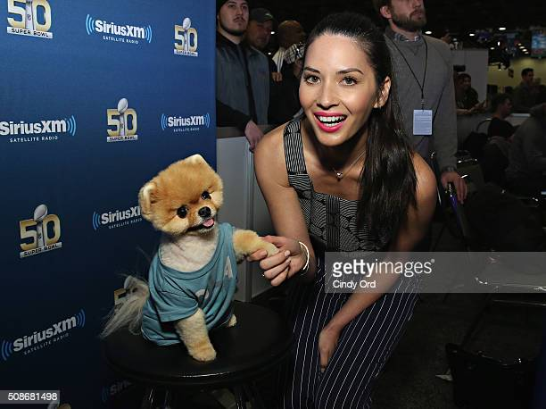 Actress Olivia Munn and Jiffpom visit the SiriusXM set at Super Bowl 50 Radio Row at the Moscone Center on February 5 2016 in San Francisco California