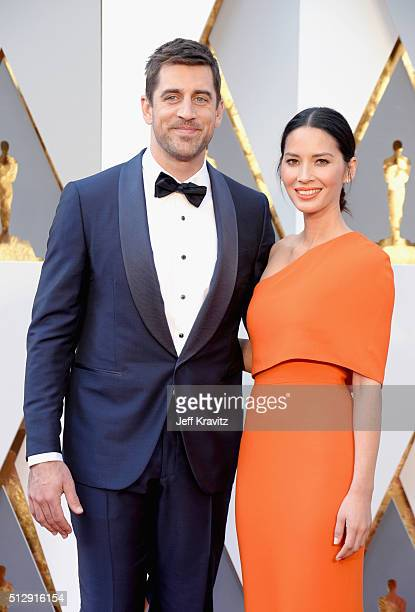 Actress Olivia Munn and NFL player Aaron Rodgers attend the 88th Annual Academy Awards at Hollywood & Highland Center on February 28, 2016 in...