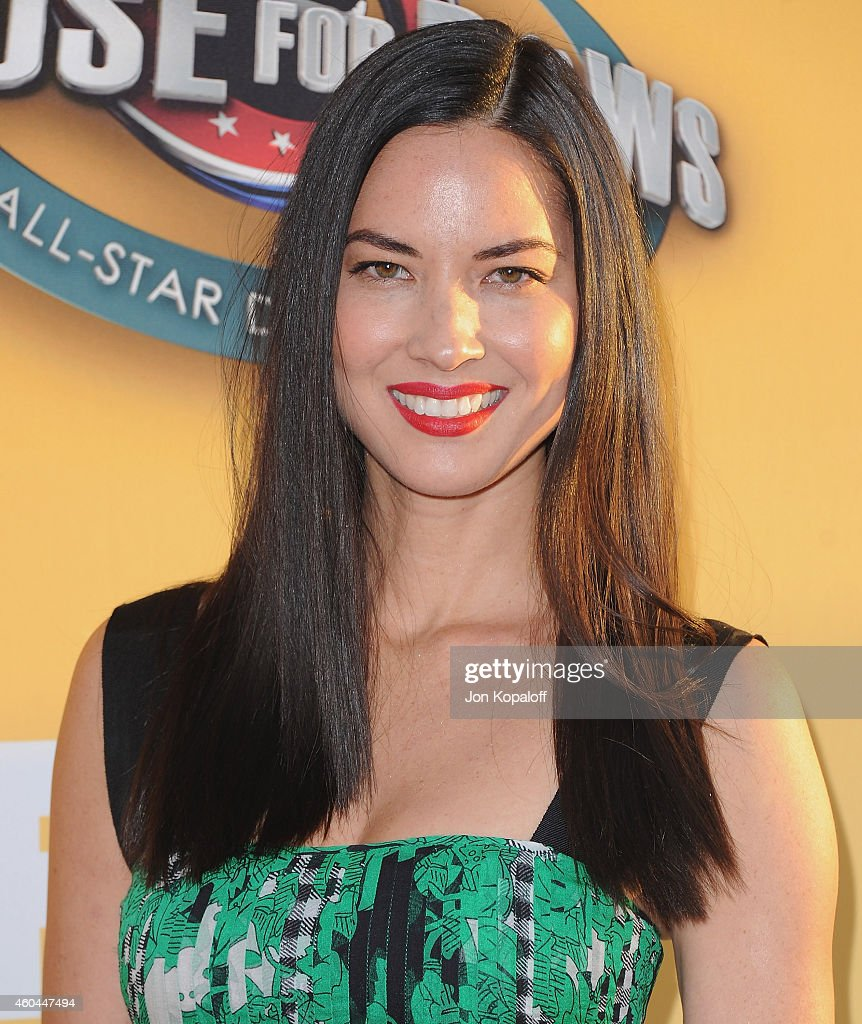 Actress Olivia Munn arrives at FOX's Cause For Paws: An All-Star Dog Spectacular at The Barker Hanger on November 22, 2014 in Santa Monica, California.