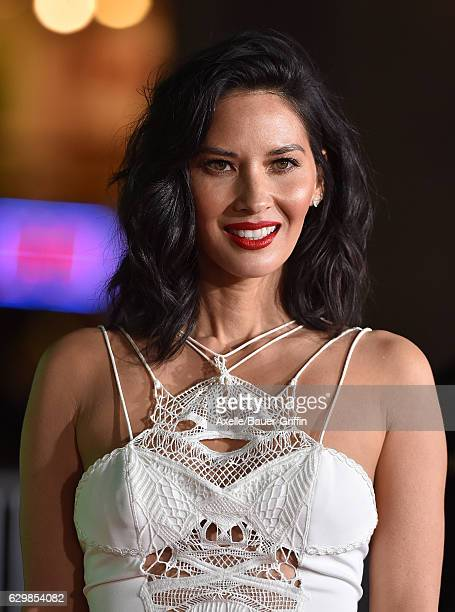 Actress Olivia Munn arrives at the Los Angeles Premiere of 'Office Christmas Party' at Regency Village Theatre on December 7 2016 in Westwood...