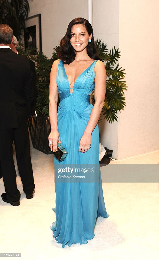 Actress Olivia Munn attends the 16th Costume Designers Guild Awards with presenting sponsor Lacoste at The Beverly Hilton Hotel on February 22, 2014 in Beverly Hills, California.