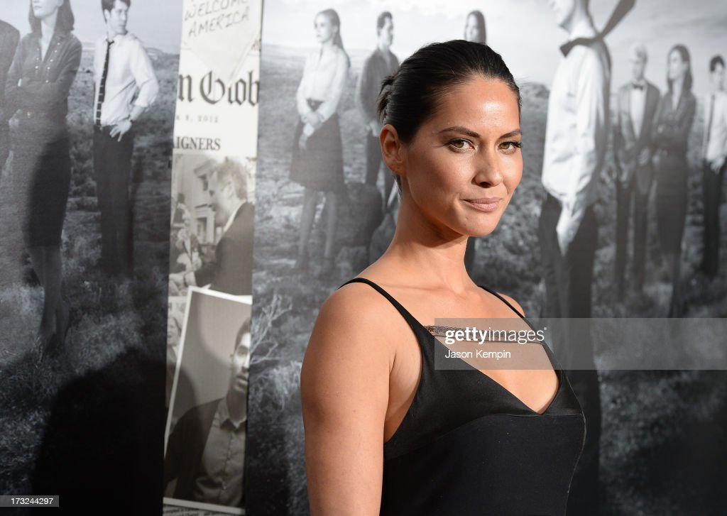 Actress Olivia Munn attends the premiere of HBO's 'The Newsroom' Season 2 at Paramount Theater on the Paramount Studios lot on July 10, 2013 in Hollywood, California.