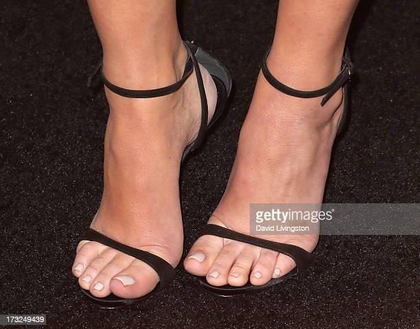 Actress Olivia Munn attends the premiere of HBO's The Newsroom Season 2 at the Paramount Theater on the Paramount Studios lot on July 10 2013 in...