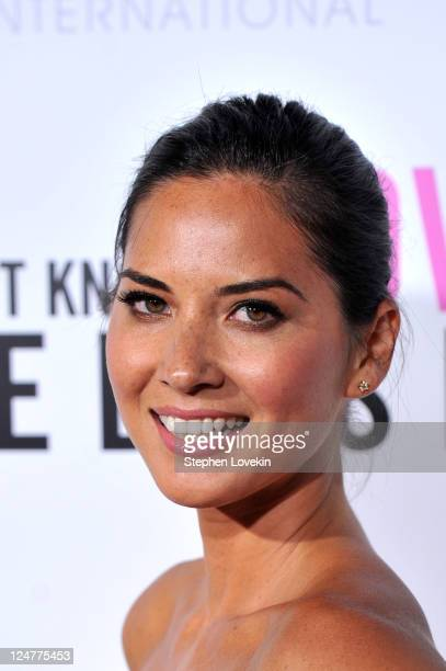 Actress Olivia Munn attends the premiere of The Weinstein Company's I Don't Know How She Does It Premiere sponsored by QVC Palladium Jewelry at AMC...