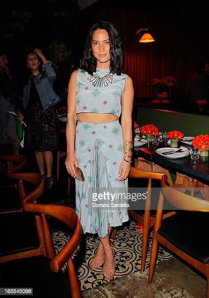 Actress Olivia Munn attends Vogue's Triple Threats dinner hosted by Sally Singer and Lisa Love at Goldie's on April 3 2013 in Los Angeles California