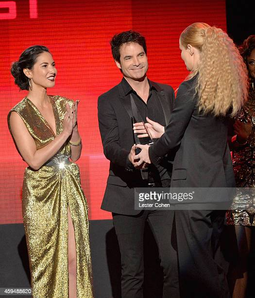 Actress Olivia Munn singer Patrick Monahan of Train and rapper Iggy Azalea speak onstage at the 2014 American Music Awards at Nokia Theatre LA Live...