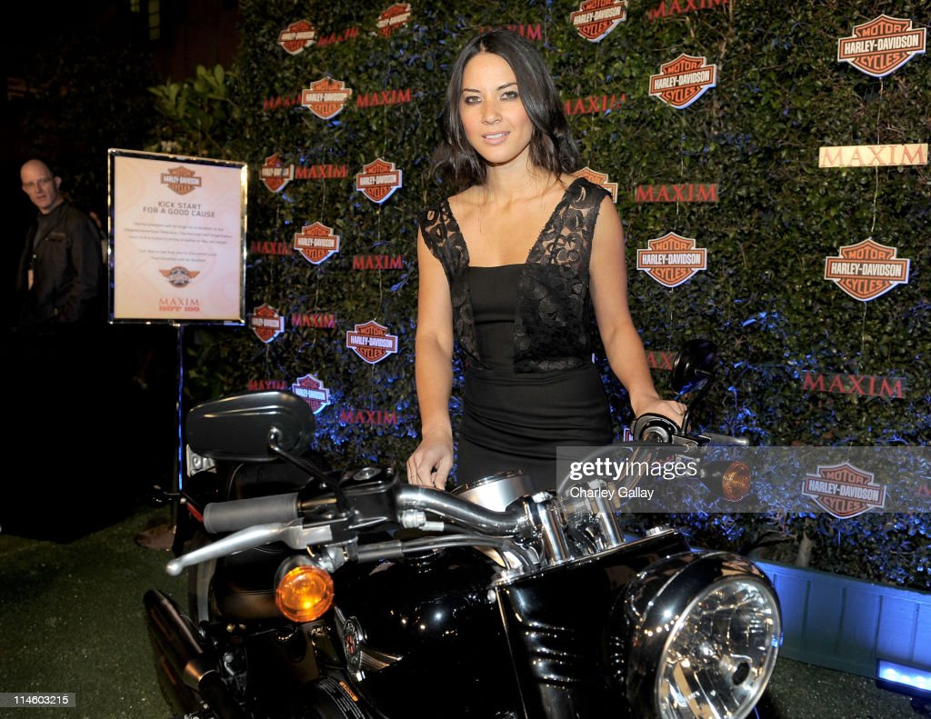 Actress Olivia Munn turns the key on a Harley-Davidson to raise money for Harley's Heroes at the 2010 Maxim Hot 100 Party held at Paramount Studios on May 19, 2010 in Los Angeles, California.