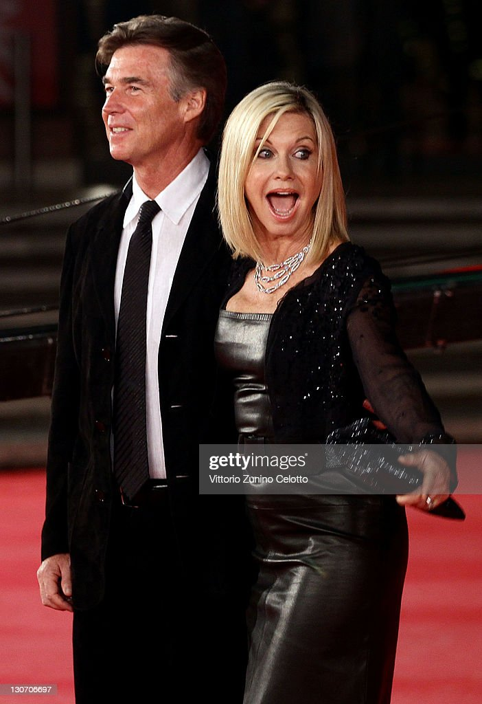 Actress Olivia Newton-John (R) and John Easterling attend the 'A Few Best Man' premiere during the 6th International Rome Film Festival at Auditorium Parco Della Musica on October 28, 2011 in Rome, Italy.